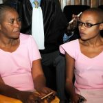 Agnes Uwimana Nkusi (R) and Saidati Mukakibibi (L) in Rwandan's Supreme Court for the first day of their appeal in Kigali on January 30 2012. Nkusi and Mukakibibi were both given in February 2011 prison sentences of 17 and seven years respectively following convictions on charges of genocide denial, inciting civil disobedience and defamation. (AFP)