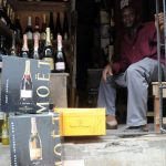 Champagne bottles displayed at a roadside shop in Lagos. (AFP)