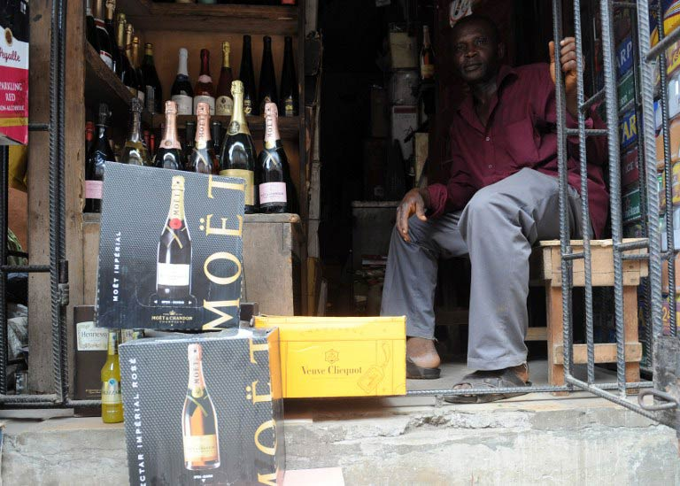Champagne bottles displayed at a roadside shop in Lagos. (AFP)