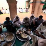 Men break their fast on the first Friday of Ramadan in a mosque at Umdowan Ban village outside Khartoum on August 5 2011. (Pic: Reuters)