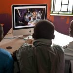 Scholars watch the film Madagascar in the computer lab at Mwelu Foundation in Mathare slum, Nairobi, Kenya. (Pic: Supplied)