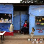 A woman waits for customers outside her shop in a Nairobi slum. (Pic: Reuters)
