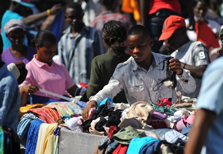A Kenyan vendor sells second-hand clothes, locally known as 'mitumba', at an open-air market in Nairobi. (Pic: AFP)