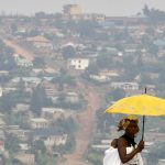 A woman walks on a main street of Rwanda's capital Kigali. (Pic: Reuters)