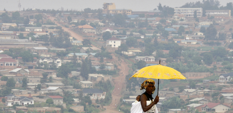 A woman walks on a main street of Rwanda's capital Kigali. (Pic: Reuters)