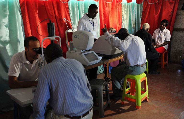 Men have their eyes tested  by technicians from the 'Nakuru Eye Disease Cohort Study'. (Pic: AFP)