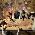 King Tutankhamun is removed from his stone sarcophagus in an underground tomb in the famed Valley of the Kings in Luxor. (Pic: AFP)