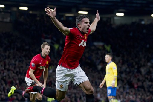Manchester United's Robin van Persie celebrates after scoring against Arsenal during their league match at Old Trafford Stadium on November 10. (Pic: AP Exchange)