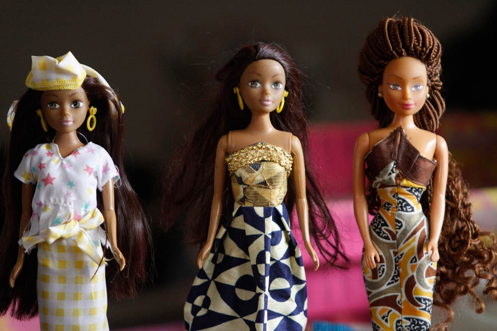 Dolls dressed in local attire are arranged on a table at a workshop in Surulere district, in Nigeria's commercial capital Lagos. (Pic: Reuters)