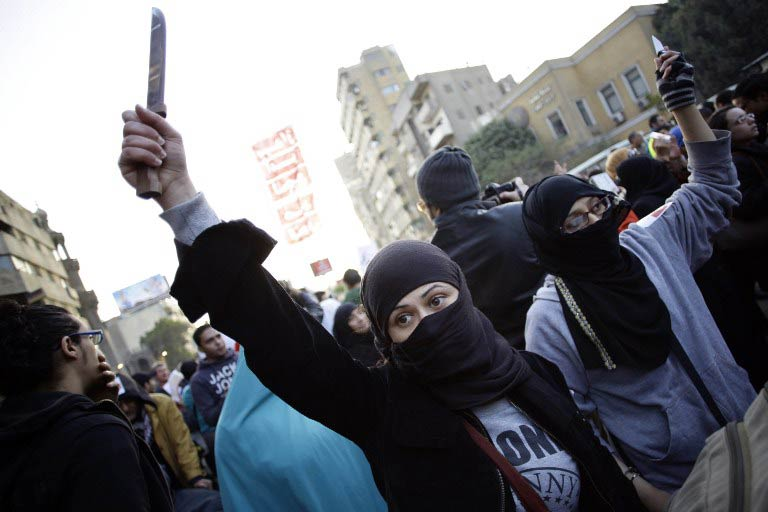 An Egyptian protester holds up a knife during a demonstration to demand an end to sexual violence against women on February 6 2013 in the Egyptian capital of Cairo. (Pic: AFP)