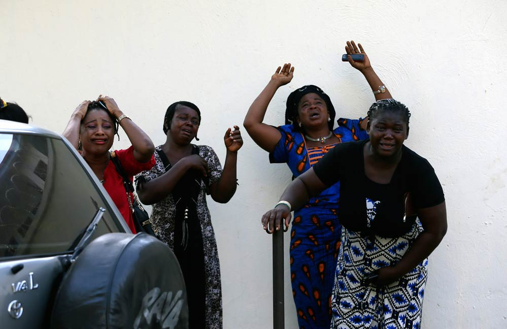 Bystanders react as victims arrive at the Asokoro General Hospital in Abuja. (Pic: Reuters)
