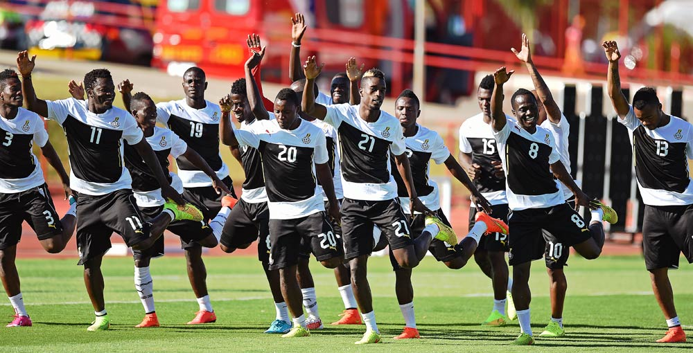 Ghana's players warm up during a training session. (Pic: AFP)