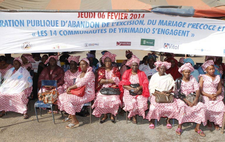 Delegations of women coming from various Malian regions attend a rally against femal genital mutilations as they sit under a banner asking for the end of excision and forced marrriage, on February 6 2014 in Bamako. (Pic: AFP)