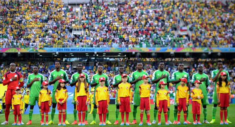 The Nigerian team sing their national anthem before taking on Iran in a Group F match on June 16. (Pic: AFP)
