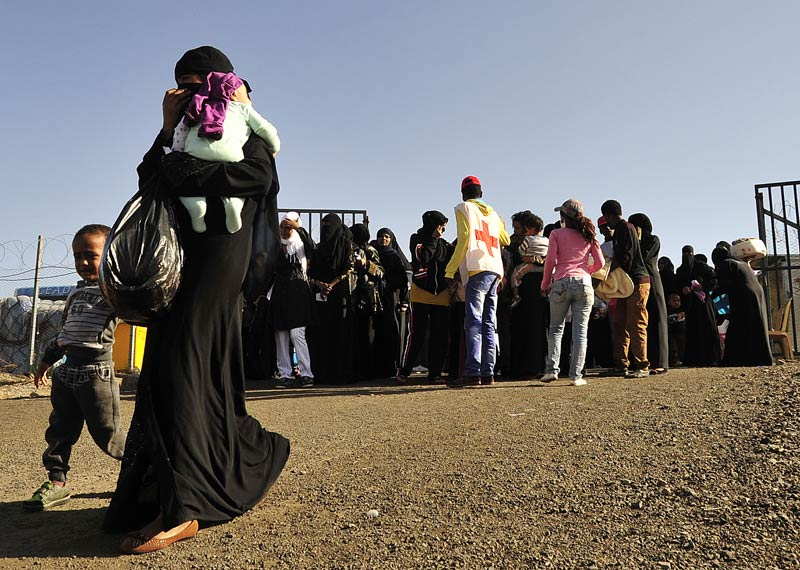 Ethiopian immigrants returning from Saudi Arabia arrive at Addis Ababa's Bole International Airport on December 10 2013.  Each year, thousands of Ethiopians facing harsh economic realities at home seek work in the Middle East, but many face abuse, low pay and discrimination. (Pic: AFP)