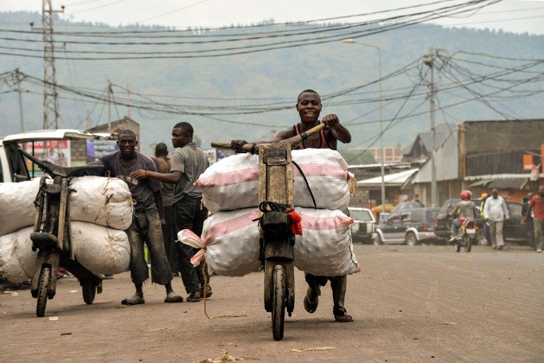 Men transport goods on tshukudus, wooden push-bikes, in Goma on June 18 2014. (Pic: AFP)