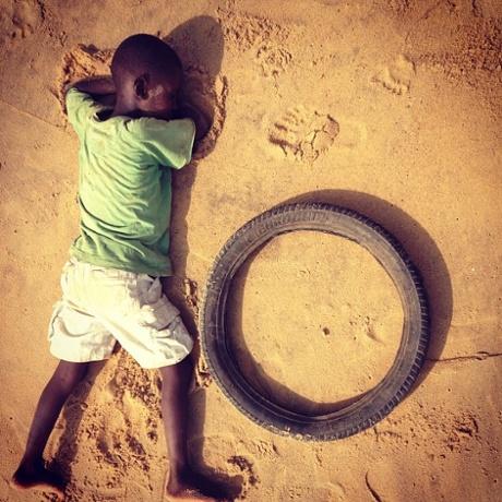Child sleeping on beach.