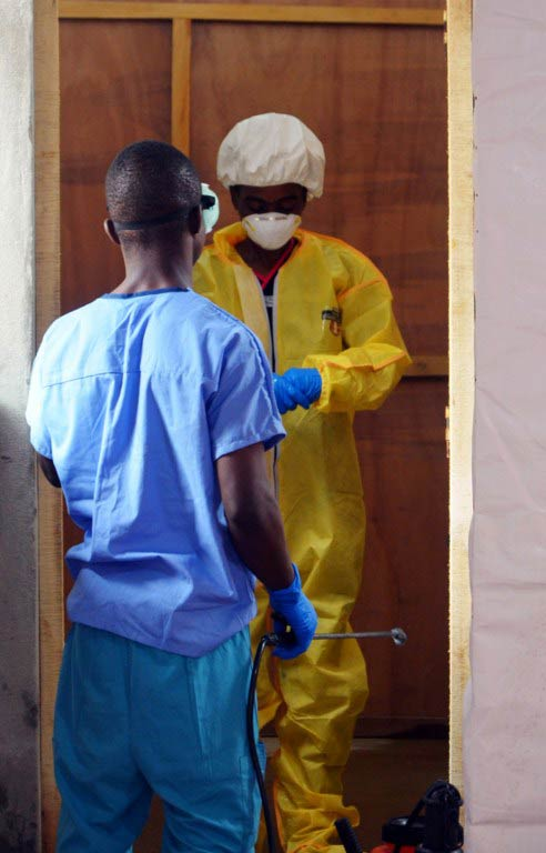 Staff and volunteers at the ELWA hospital in the Liberian capital Monrovia wearing protective gear. (Pic: AFP)
