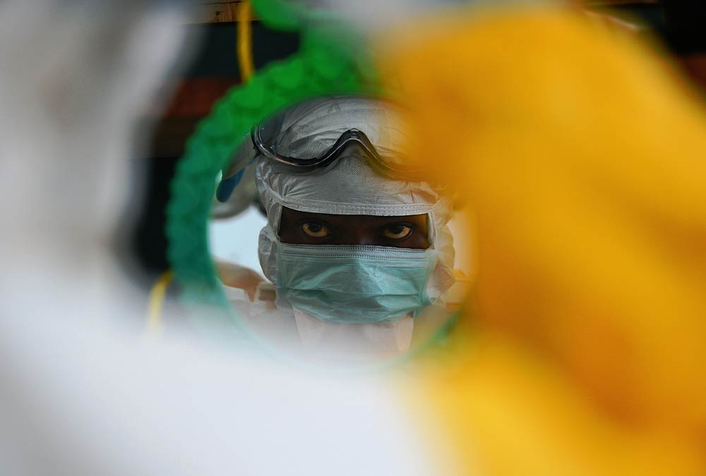 A medical worker checks his protective clothing  at an MSF facility in Kailahun, Sierra Leone. (Pic: AFP)