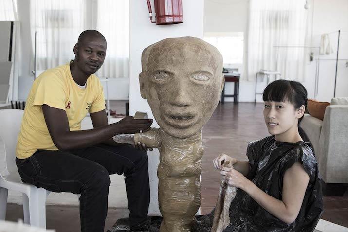Macdonald Mfolo and Jenny Lai constructing a puppet head. (Pic: Chris Saunders)