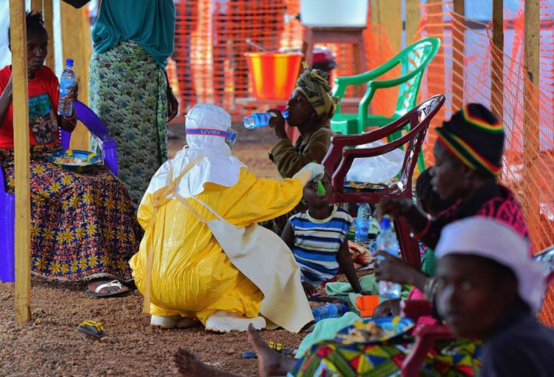 An MSF medical worker feeds a child at an MSF facility in Kailahun on August 15 2014. Kailahun along with Kenama district is at the epicentre of the world's worst Ebola outbreak. (Pic: AFP)