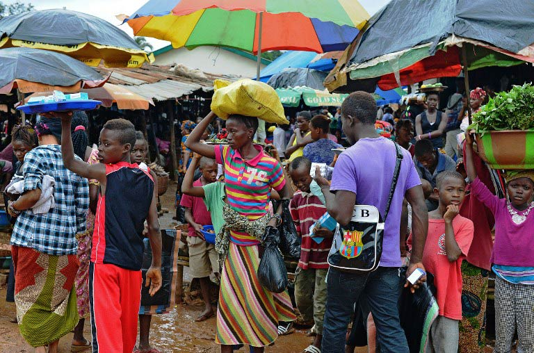 Locals in a market in Kenema, Sierra Leone. (Pic: AFP)