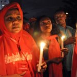 Campaigners for the release of the abducted Chibok schoolgirls hold candles at a vigil for them on October 12 2014 in Abuja. (Pic: AFP)