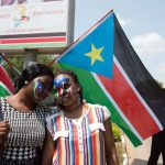 Women with their faces painted with the South Sudanese flag pose during celebrations marking three years of independence in Juba on July 9,2014.