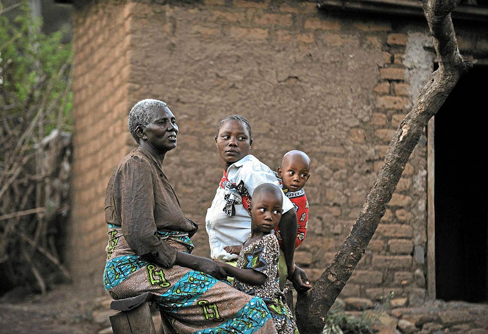 Safety: Mtongori Chacha (left) and her wife, Gati Buraya, with their children. The women say their union saves them from abuse by men. (Pic: AFP)