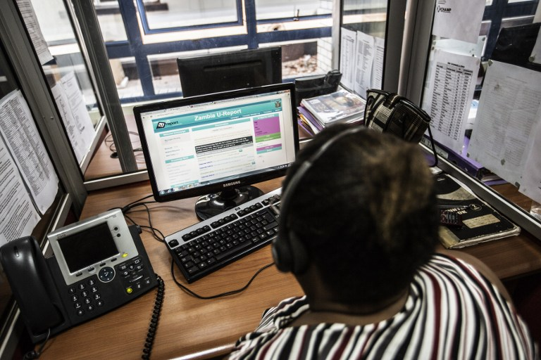 An Zambian HIV counsellor looks at phone text messages coming up on the U-report platform for HIV and Aids awareness at a call centre in Lusaka. (Pic: AFP)