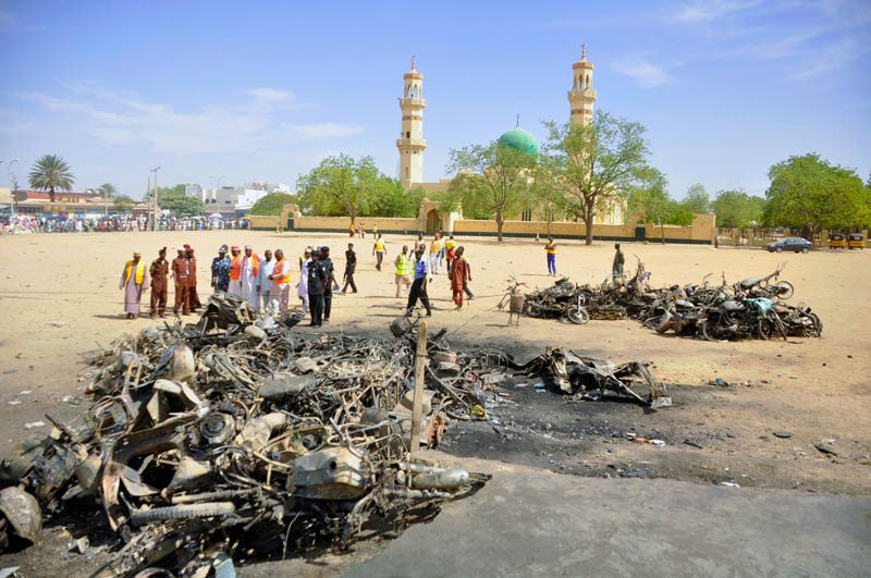 Investigators at the scene of the Kano Central Mosque bombing on November 29 2014. Gunmen set off three bombs and opened fire on worshippers at the main mosque in north Nigeria's biggest city Kano, killing at least 81 people. (Pic: AFP)