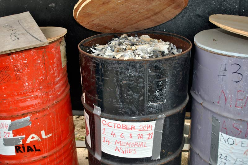 Bone fragments are seen in a barrel of the cremated remains of Ebola virus victims in Boys Town on January 9 2015. (Pic: Reuters)