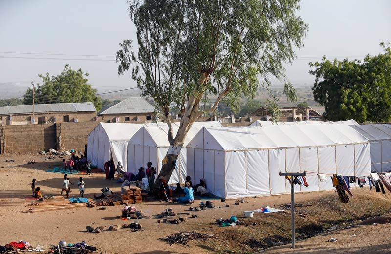 People displaced as a result of Boko Haram attacks in the northeast region of Nigeria, are seen near their tents at a faith-based camp for internally displaced people in Yola, Adamawa State. (Pic: Reuters)