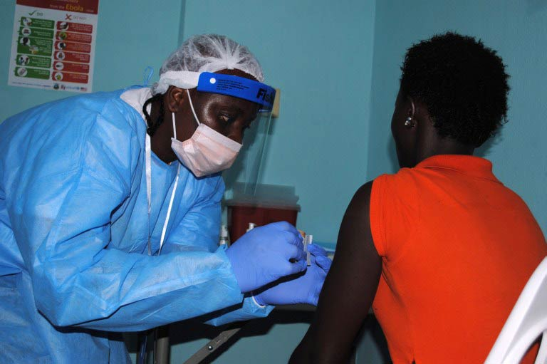An adhesive bandage is placed on the arm of a volunteer after she was administered an experimental Ebola vaccine at Redemption Hospital in New Kru Town, a suburb of Monrovia, on February 2. (Pic: AFP)