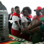 President Robert Mugabe cuts his birthday cake with his children and his wife Grace Mugabe during a 21st February Movement celebrations rally held in honor of his 89th birthday at Chipadze stadium in Bindura on March 2 2013. (Pic: AFP)