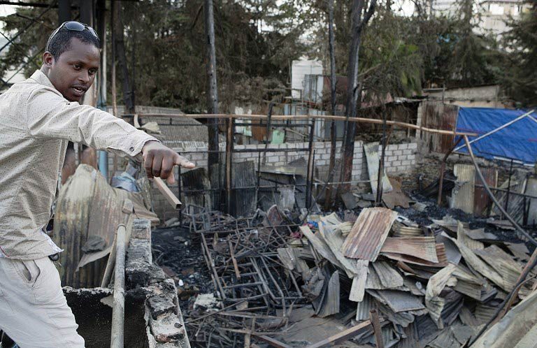 Misale Legesse, an Ethiopian jazz drummer,shows the damage from a fire that ripped through Jazzamba jazz club, a milestone for Ethio-jazz in Addis Ababa, on February 16 2015. (Pic: AFP)
