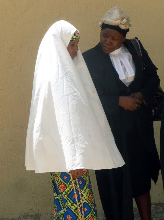 Wasila Tasiu speaks with her defence counsel outside the courtroom during her first day of trial in October 2014. (Pic: AFP)
