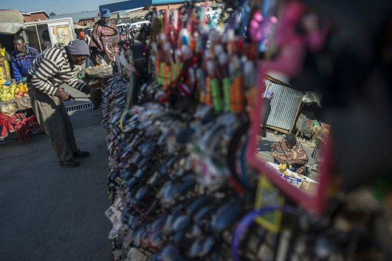 People shop at a market in Maseru on August 31 2014. (Pic: AFP)
