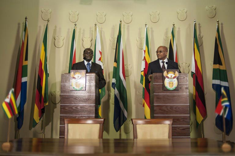 Zimbabwe's President Robert Mugabe (L) and South Africa's President Jacob Zuma deliver a speech before the signing of various memorandum of understanding between the two countries at the Union Buildings in Pretoria on April 8 2015. (Pic: AFP)