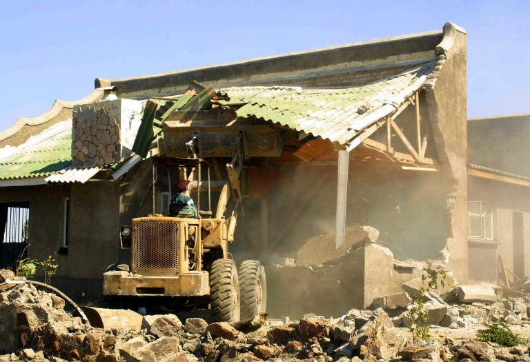 A picture taken on June 17 2005 shows a house being destroyed in Chitungwiza, about 30km south of Harare, as part of Robert Mugabe's government clean-up campaign named Operation Murambatsvina. (Pic: AFP)
