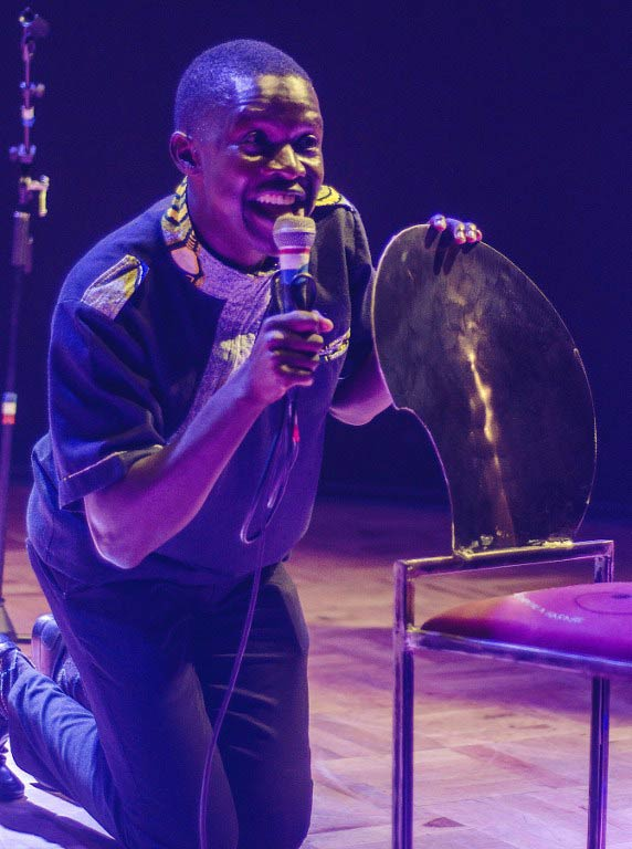 Victor Mpofu aka Doc Vikela performs during his stand-up comedy at the Bang Bang Club in Harare, on February 26 2015. (Pic: AFP)