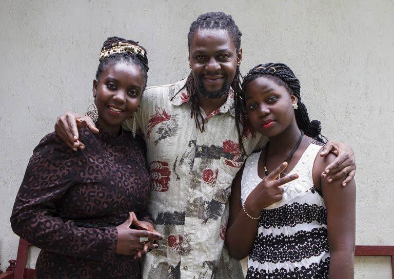 "Host Sharon Bwogi aka Lady Slyke (L), writer and producer Daniel Kisekka aka ""Survivor"" (C) and rapper Zoe Kabuye aka ""MC Loy"" at the company's office in Kampala. (Pic: AFP)"