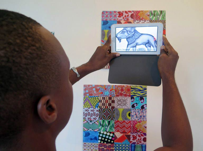 A man tries out Wakpon, a new smartphone application that allows people to view pictures and works of art. (Pic: AFP)