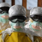 Healthcare workers, wearing protective suits, leave a high-risk area at the French NGO Médecins Sans Frontières Elwa hospital in Monrovia, Liberia. Pic: Dominique Faget/AFP