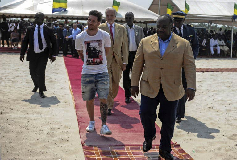 Argentinian soccer player Lionel Messi (C) is given a tour during the start of construction of the Port-Gentil Stadium by the President of Gabon, Ali Bongo Ondimba (R). (Pic: AFP)