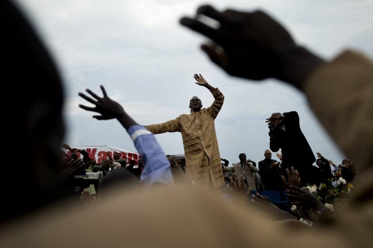 Ugandans participate in a massive preach of the Born Again Church in Mbarara, western Uganda's largest town, on August 23 2008. (Pic: AFP)