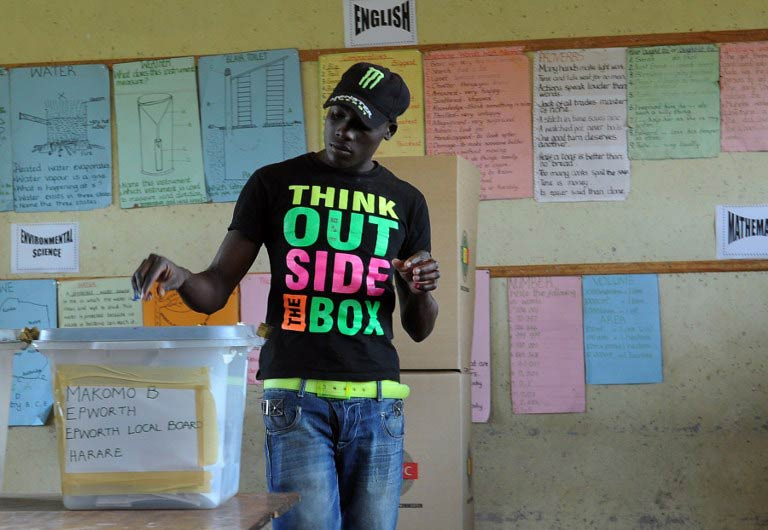 A Zimbabwean casts his vote in Epwath on March 16 2013 during a referendum on a new constitution that would curb President Robert Mugabe's powers and pave the way for elections later in the year. (AFP)