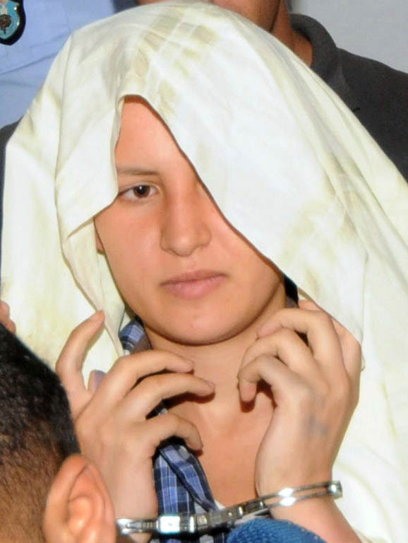 Amina appears handcuffed at the courthouse in the central city of Kairouan on June 5 2013. (AFP)