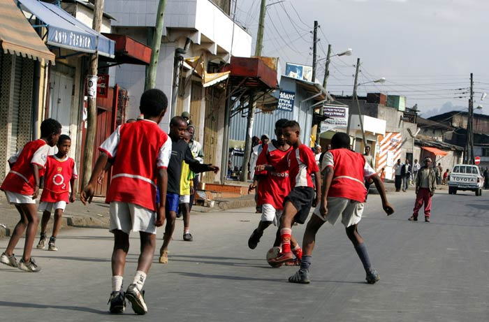 Young boys playing soccer on the streets of Addis Ababa. (Reuters)