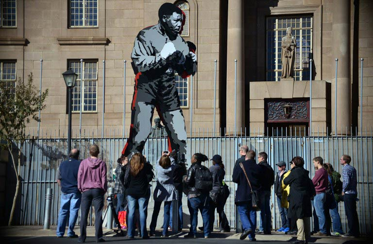 The six metre-high 'Shadow Boxer' sculpture in Johannesburg's inner city depicts Nelson Mandela as a young boxer. (AFP)